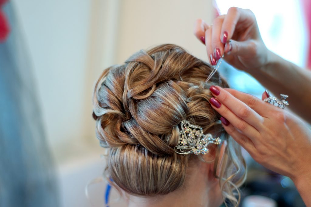 A bride having wedding hair done in Bideford Spa